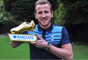 Harry on lawn with golden boot